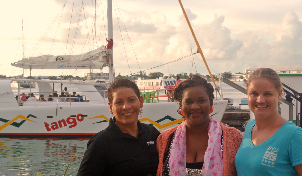 Representatives of the Positive Foundation, Elektralyets and Aqua Mania Adventures standing in front of Tango, one of the boats used in the Pink Sunset Sail